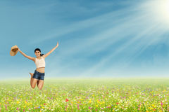 Woman jumping on the park Stock Photography