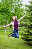 Woman jumping on path Stock Images