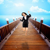 Woman Jumping On The Pier Stock Photos