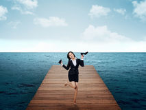 Woman Jumping On The Pier Royalty Free Stock Photo