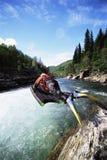 Woman jumping into river Royalty Free Stock Photos