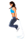Woman jumping rope Royalty Free Stock Images