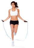 Woman jumping rope Stock Images