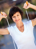 Woman with jumping rope. Active middle aged woman with jumping rope Stock Photos