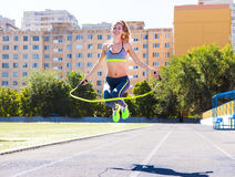 Woman with jumping rope. Beautiful young woman with a jumping ro Royalty Free Stock Photos