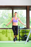 Woman jumping with rope, jumping rope. In a fitness club or gym Royalty Free Stock Photos