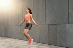 Woman jumping rope outside Royalty Free Stock Photos