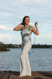 Woman Jumping Rope. Physically Fit Woman Jumping Rope Outdoors Stock Photos