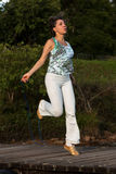 Woman Jumping Rope. Physically Fit Woman Jumping Rope Outdoors Royalty Free Stock Photo