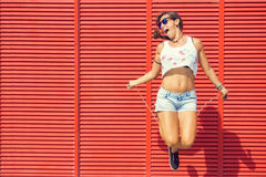 Woman jumping rope Stock Photos