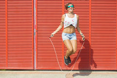 Woman jumping rope Stock Photography