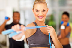 Woman jumping rope. Smiling women exercise in gym with jumping rope Royalty Free Stock Photos