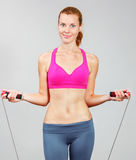Woman with jumping rope Royalty Free Stock Photos