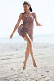 Woman jumping on the sand Royalty Free Stock Photo