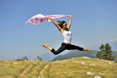 Woman jumping with a scarf royalty free stock images