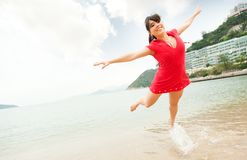 Woman jumping in the sea Stock Photography