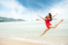 Woman jumping in the sea Royalty Free Stock Photography