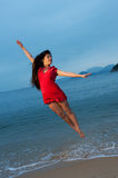 Woman jumping in the sea Royalty Free Stock Photos