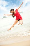 Woman jumping in the sea Stock Photo