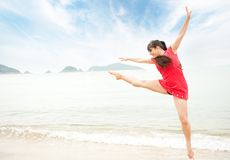 Woman jumping in the sea Stock Image