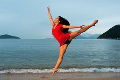 Woman jumping in the sea Royalty Free Stock Image