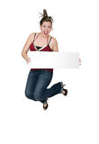 Woman jumping with sign. A young girl jumping with a blank message board Stock Image