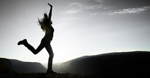 Woman Jumping royalty free stock photography