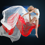 Woman jumping with silk fabric Stock Image