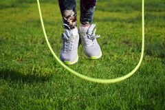 woman jumping on a skipping rope in park Stock Images