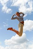 Woman jumping sky Stock Images