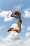 Woman jumping sky Stock Photography