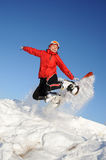 Woman jumping with snowboard Stock Photos