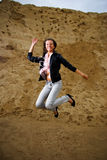 Woman jumping - success. Successful woman is jumping with landscape in background Royalty Free Stock Photos