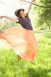 Woman Jumping In Summer Field Stock Photos