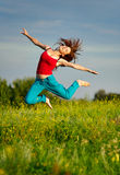 Woman jumping on a sunset Stock Image