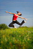Woman jumping on a sunset Royalty Free Stock Images