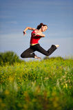Woman jumping on a sunset Royalty Free Stock Photography