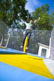 Woman jumping on trampoline Royalty Free Stock Photography