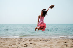 Woman jumping on a tropical beach Royalty Free Stock Images
