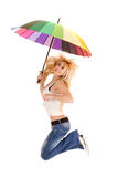 Woman jumping with umbrella Royalty Free Stock Images