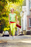 Woman jumping walking city street Royalty Free Stock Image