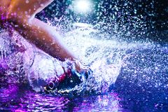 Woman jumping on water Royalty Free Stock Image