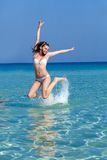 A woman is jumping in water Royalty Free Stock Image