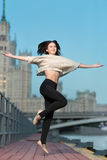 Woman jumping on waterfront Stock Photos