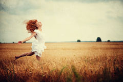 Woman jumping at wheat field Royalty Free Stock Photography