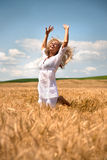 Woman jumping in wheat field stock photography