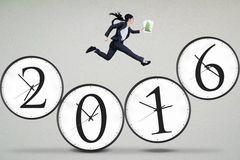 Woman jumps on the clock with numbers 2016 Royalty Free Stock Image
