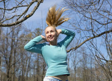 Woman jumps in the early spring wood Stock Photography