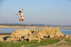 A woman jumps for joy Royalty Free Stock Photo