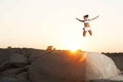 A woman jumps for joy Royalty Free Stock Photography